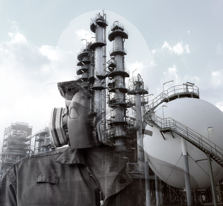 black and white double exposure of Engineer with mask respirator  and safety helmet in front of oil refinery and petrochemical plant