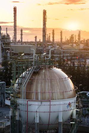Gas storage spheres tank in oil refinery plant at sunrise,Factory at morning time