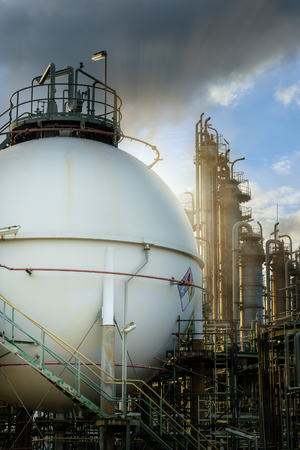 Gas storage spheres tank in oil refinery plant at sunrise