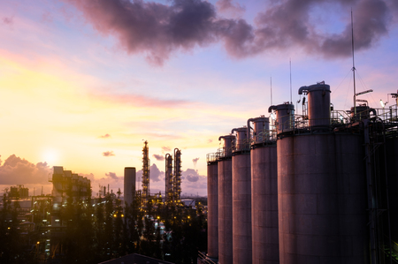 silos in petrochemical industry plant at beautiful sunrise