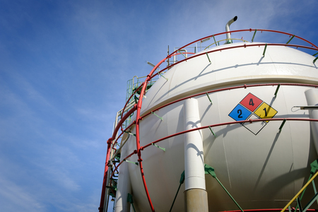 close up sphere tank gas in petrochemical plant with blue sky background