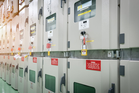 key lock electrical switch gear for isolate system.,Industrial electrical switch panel at substation of power plant.