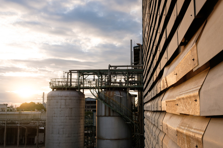 Storage,Chemical tanks in petrochemical industry plant at sunrise