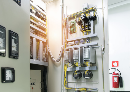 Electrical panel at a assembly line factory. Electricity distribution box. Wires in electrical cabinet