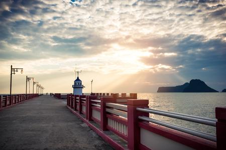 Lighthouse and sun rise at Prachuap Khiri Khan, Thailand,The jetty Lighthouse Khiri Khan, Thailand. Standard-Bild