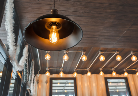 Vintage light bulb in coffee shop,classic and retro concept style.