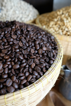 Many coffee grains on rough fabric, Roasted coffee beans on sacking