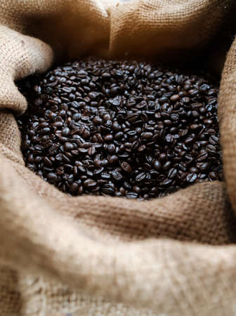 Many coffee grains on rough fabric,Roasted coffee beans on sacking Standard-Bild