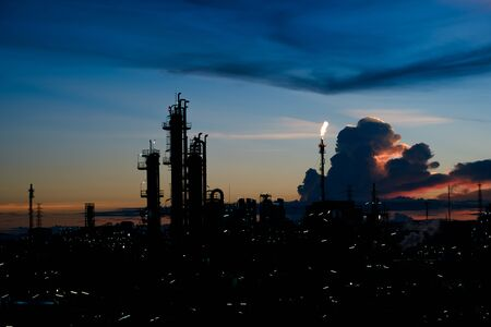 silhouette factory with dramatic sky background,petrochemical plant area with beautify sky at sunset.industry factory at sunset time.