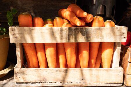 Fresh carrot in wooden box,Carrots in wooden box on sale in market.