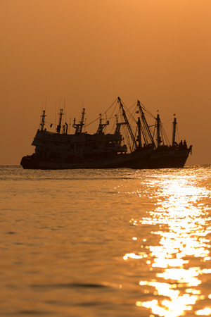 The fishing boat on the sea photo