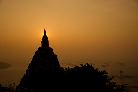 sillhouette: the sillhouette little pagoda with sunset