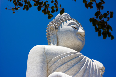 the white big buddha with blue sky photo