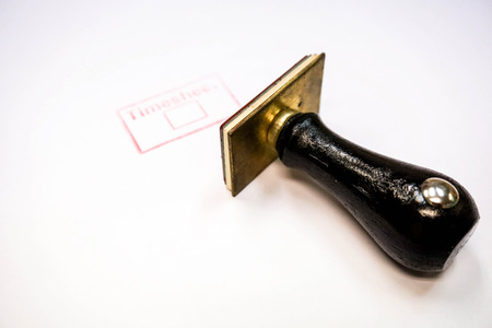 Rubber stamp with timesheet in red color Stock Photo