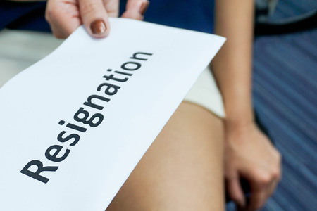 Woman submit a resignation letter