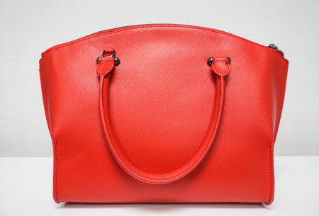 isolated light red woman bag