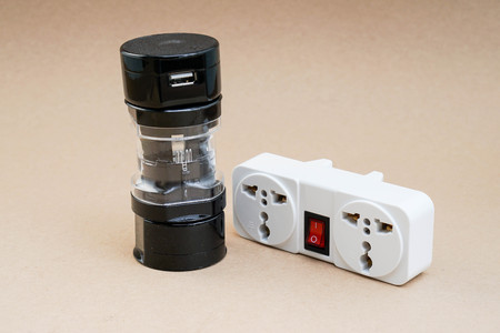 plug socket: Isolated universal adaptor with plug socket for travelling