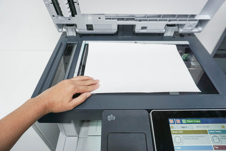 Place a paper on the printer for scanning Stock Photo