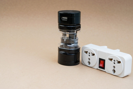plug socket: universal adaptor with plug socket for travelling Stock Photo
