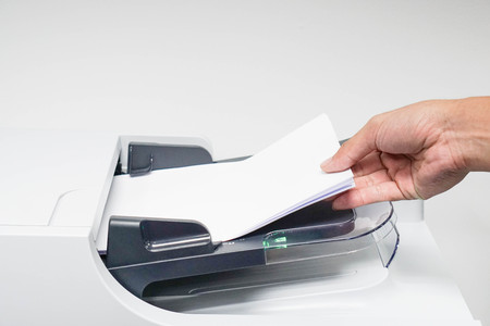 xerox: businessman is printing, copying and scanning the documents