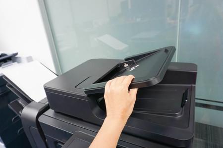 xerox: businesswoman lift the printer feeder Stock Photo