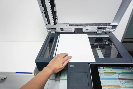 xerox: place paper on printer plate for scanning