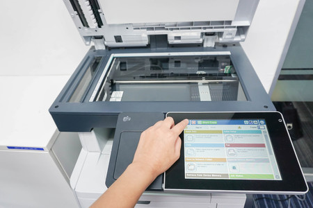 xerox: close up businesswoman with touchscreen of office printer Stock Photo