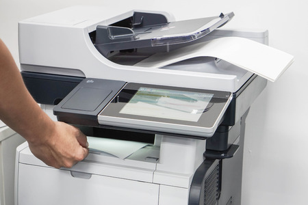xerox: close up man take printed business documents from printer