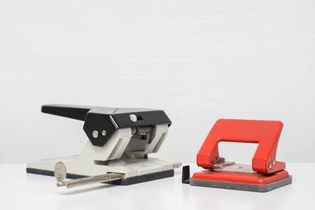 paper punch: isolated paper punch on table