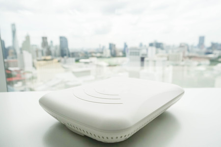 isolated access point on the office desk with city view Standard-Bild