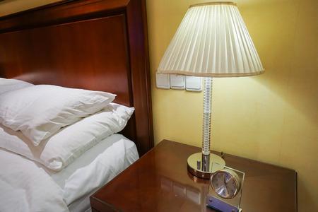 bedside: bright vintage lamp at bedside in bedroom
