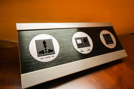 plug socket: modern style plug socket in hotel bedroom Stock Photo