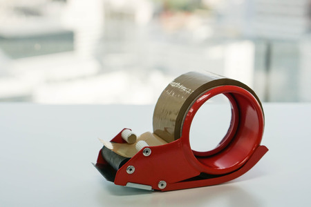 brown adhesive tape with dispenser