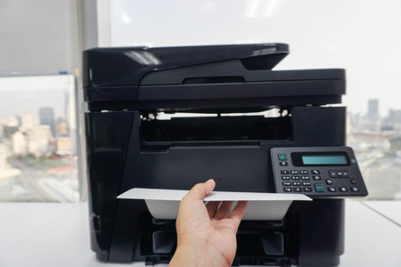 left hand: businesswoman bring printed documents from office printer with left hand