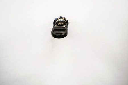 isolated close up drawer key in keyhole