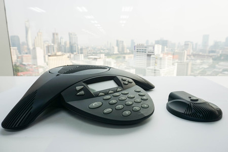 close up IP conference phone with wireless speaker on table for meeting Stock Photo
