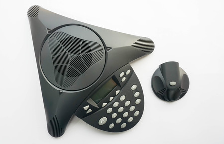 telephonic: top view isolated IP conference phone with portable speaker for meeting Stock Photo