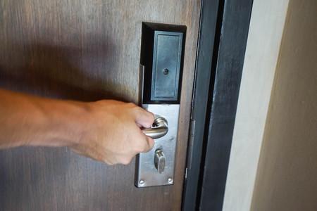 door knob: close up man twist hotel doorknob for enter the room
