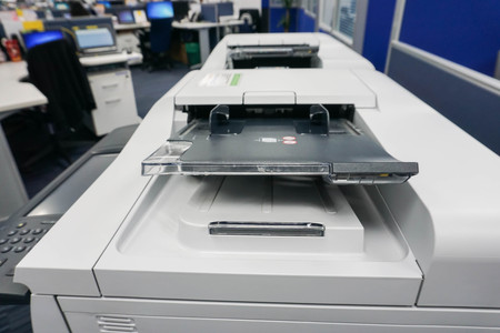 close up multifunction printer tray in office with selective focus
