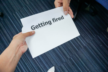 close up business concept of  boss fired his employee