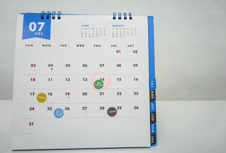 isolated July calendar with meeting, appointment and bill payment due date