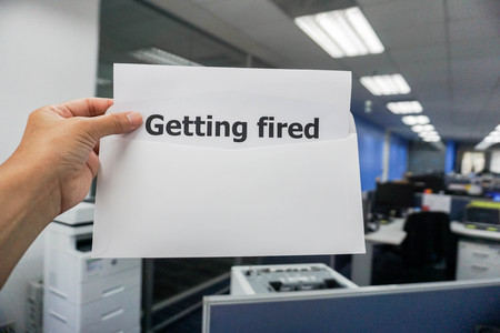 business concept of getting fired notification letter to the employee in office