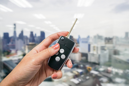 close up women hold modern car remote control Stock Photo