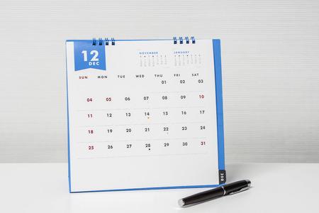 arrange December meeting on calendar with pen