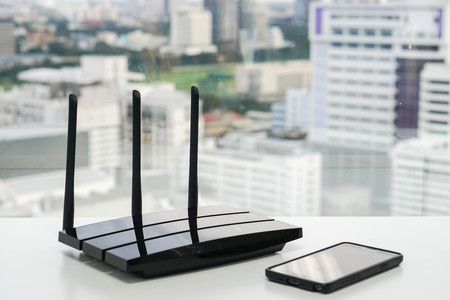 WiFi router with smartphone Stock Photo