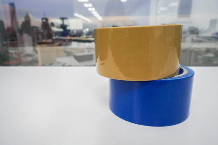 close up adhesive tapes on white table Stock Photo
