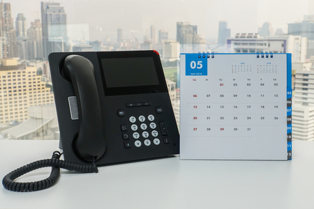 IP phone with May 2018 calendar for business meeting reminder in office Standard-Bild