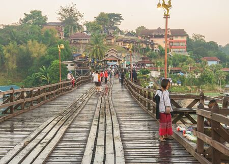 Sangklaburi  Kanchanaburi, Thailand - December 22 2017: Mon cute girl on the wooden bridge 에디토리얼