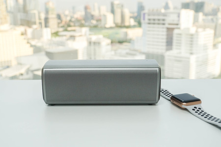 isolated portable wireless speaker with smartwatch Stock Photo