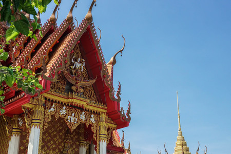 decorated Buddhist monastery in temple with blue sky